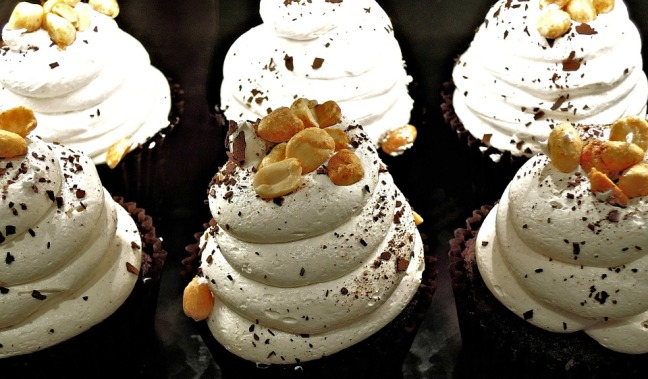 Marshmallow and peanuts atop chocolate cupcakes